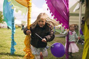 Girl with balloon running