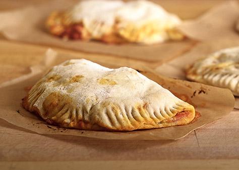 bigstock-Freshly-Baked-Calzone-72389542