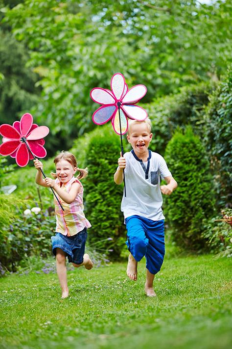 bigstock-Two-happy-children-running-wit-120806903